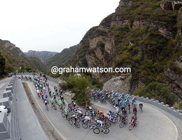 The peloton climbs a brutally steep hill after 60-kilometres - they are less than three minutes behind the escape...