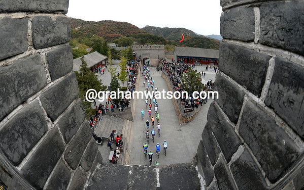 The peloton passes through The Great Wall at Badaling, scene of the 2008 Olympic Games Road Race...