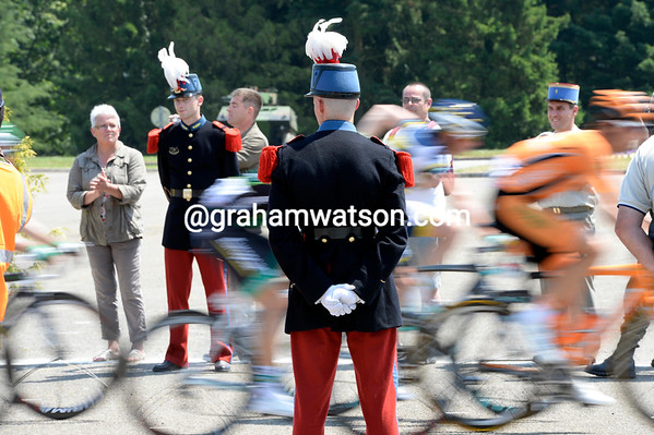 The peloton speeds through France's special military academy at Saint-Cyr, watched by trainee officers...