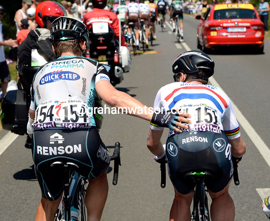 Big brother help sees Tony Martin pushing Mark Cavendish while he fixes his shoes...