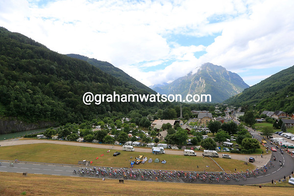 The peloton starts the ascent to the Col du Glandon, in nonchalent pursuit of a very big escape...
