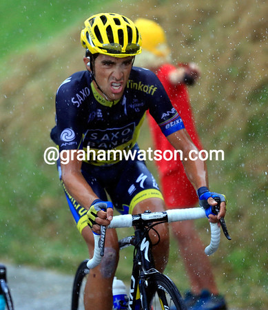 Alberto Contador is having a tough day as well - not helped by the pouring rain...