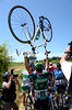 A huge crash blocks the road after 20-kilometres - Tommy Voeckler tries to walk his way through the melée...