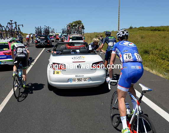 There's a queue for riders needing medical attention at the doctor's car, but most are for minor cuts and bruises...