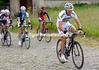 Gilbert goes right past Cancellara on the cobbled climb...