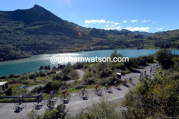 The peloton speeds past the Embalse de Lanuza, unable to even glance at the sparkling waters...