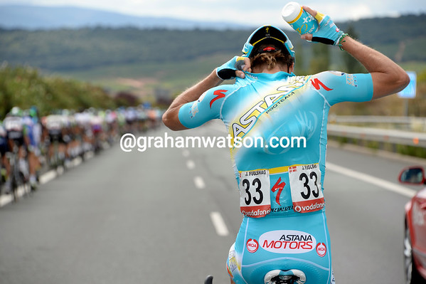 At such speeds, only a strong rider can go back and collect water bottles - Jacob Fuglsang obliges for Astana...