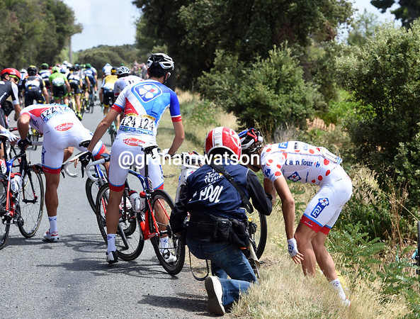 The day's first crash involves Thibaut Pinot...