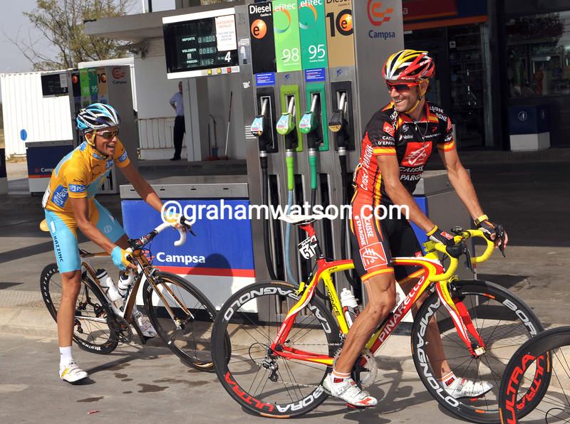 Alejandro Valverde and Alberto Contador makes a pretend fill-up on stage 21 of the 2008 Vuelta a España