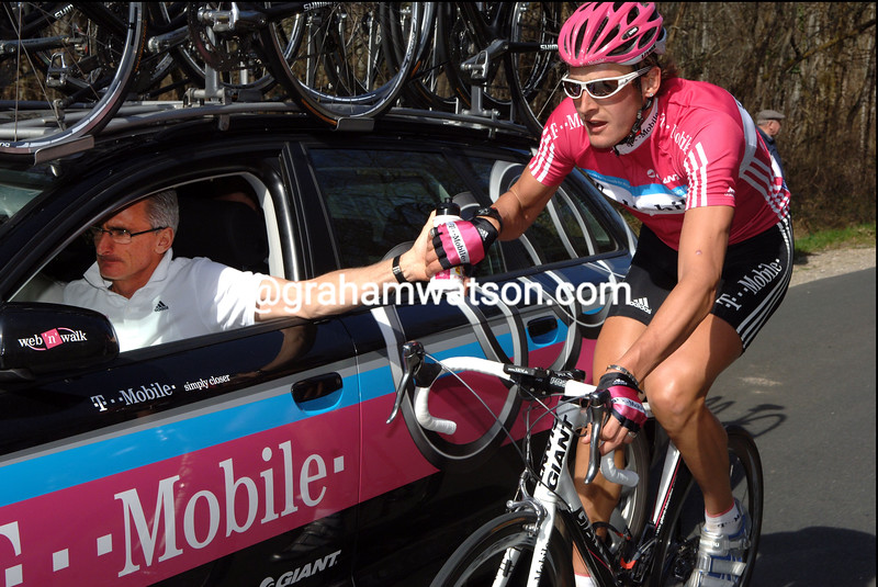 MARCUS BURGHARDT GETS A bottle from allan peiper ON STAGE TWO OF PARIS-NICE