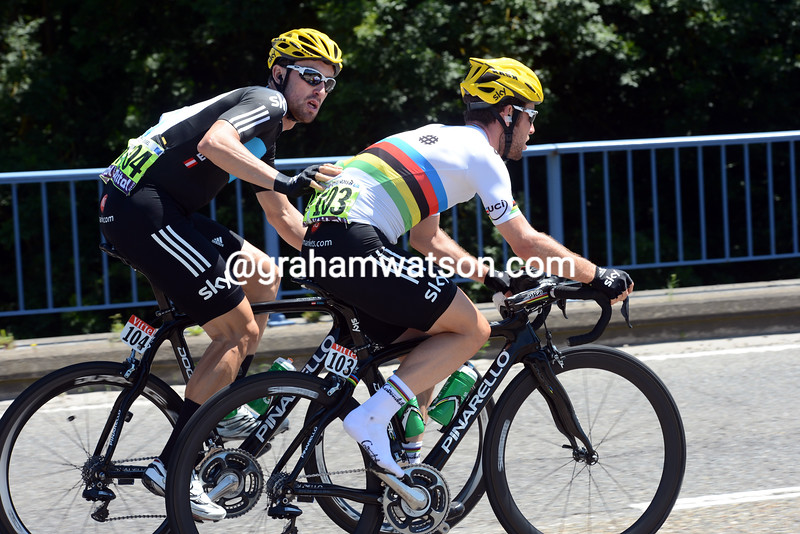 Mark Cavendish is pushed by Bernhard Eisel on stage two of the 2012 Tour de France