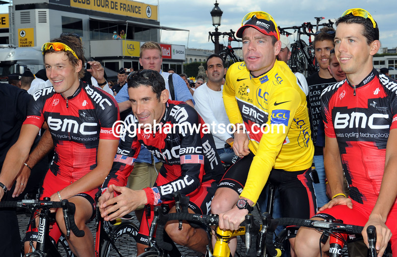 GEORGE HINCAPIE & TEAM MATES CELEBRATE WITH CADEL EVANS AFTER THE FINISH OF THE 2011 TOUR DE FRANCE