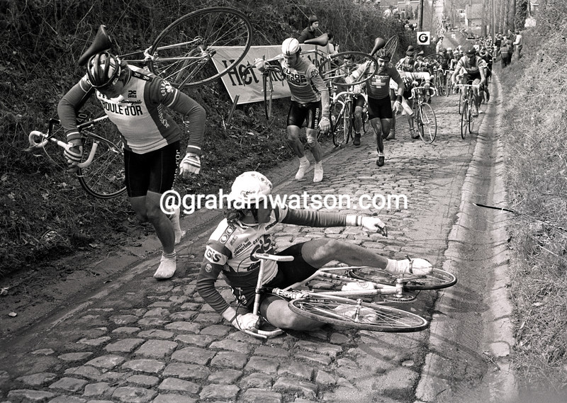 CYCLISTS WALK ON THE KOPPENBERG IN THE 1981 TOUR OF FLANDERS