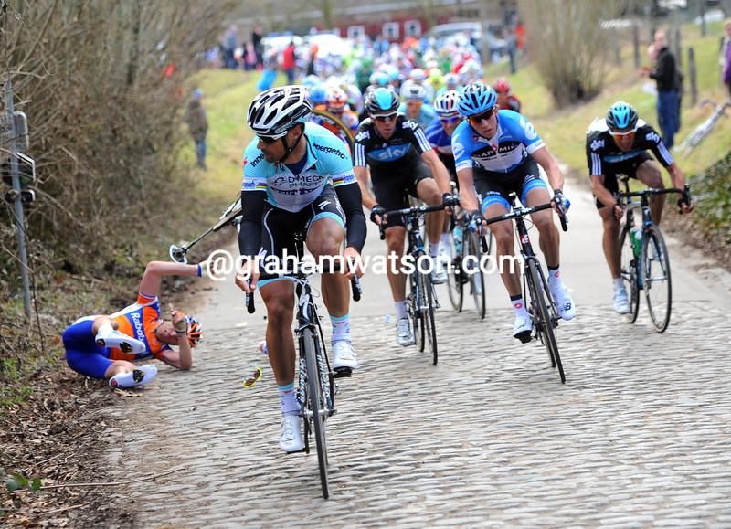 Tom Boonen looks at Lars Boom's crash in the 2012 Omloop Het Nieuwsblad