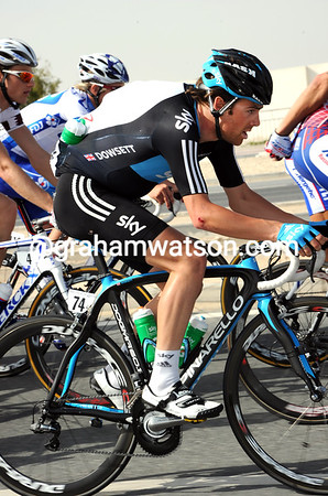 ALEX DOWSETT CARRIES WATER BOTTLES ON STAGE FIVE OF THE 2011 TOUR OF QATAR
