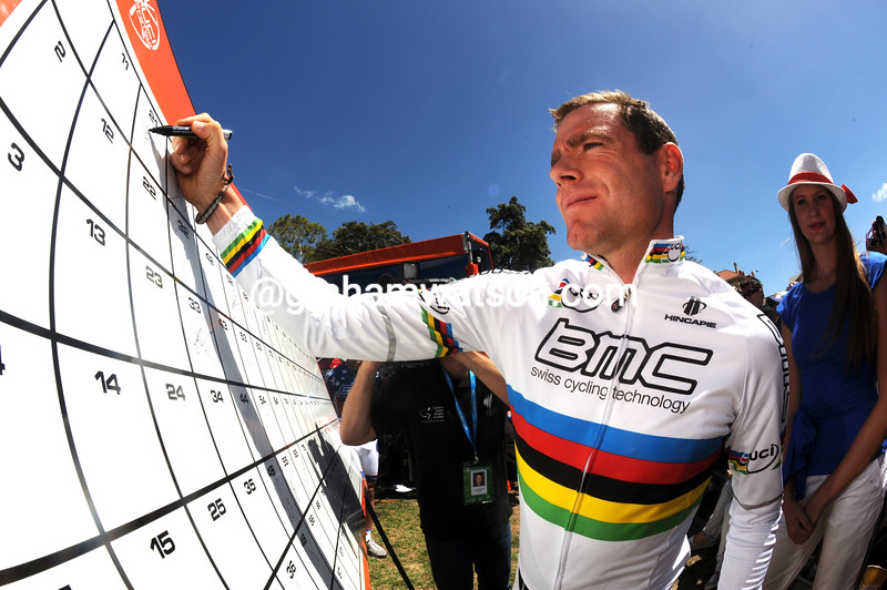 Cadel Evans signs on in his first race as World Champion in the 2012 Tour Down Under..