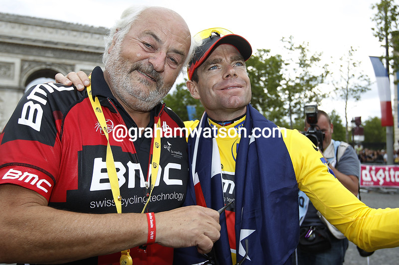 CADEL EVANS WITH ANDY RIHS ON STAGE TWENTY ONE OF THE 2011 TOUR DE FRANCE