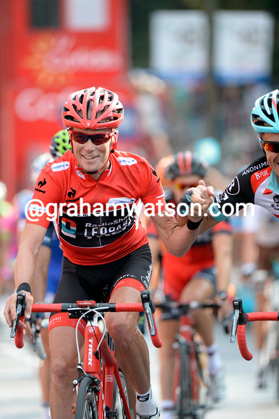 Horner is cheered by teamate Markel Irizar as they cross the line...