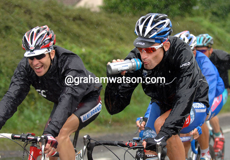 Christian VandeVelde jokes with George Hincapie on a stage of the 2009 Tour of Switzerland