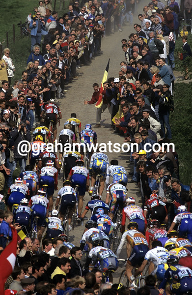 Cyclists climb in the 2000 Paris-Roubaix