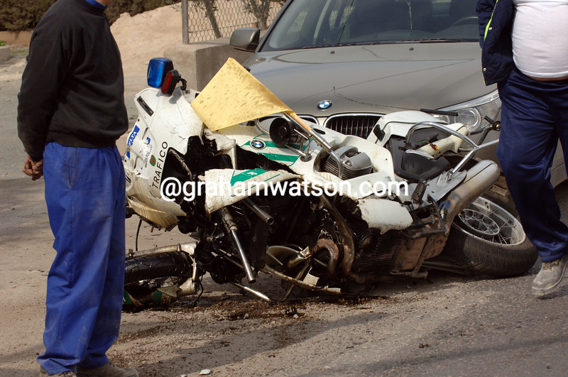 A motorbike from the Guardia Civil lies wrecked after a crash in the 2006 Tour of Murcia