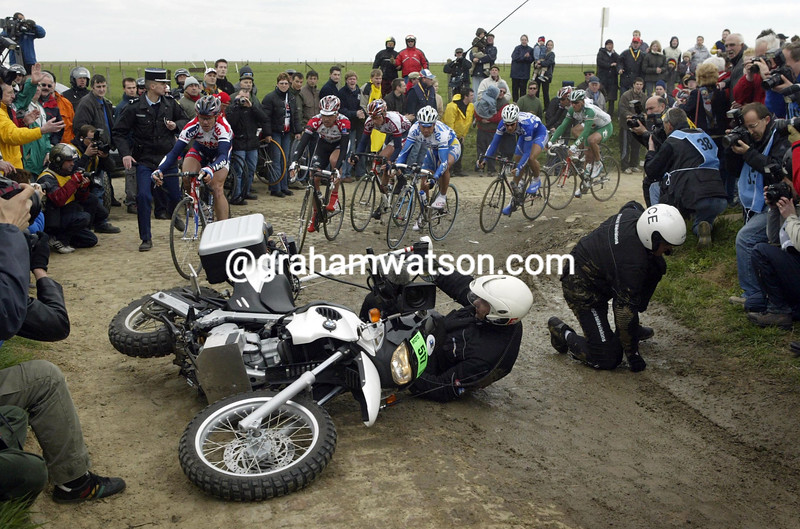 A TV MOTORCYCLE CRASHES IN THE 2005 PARIS-ROUBAIX