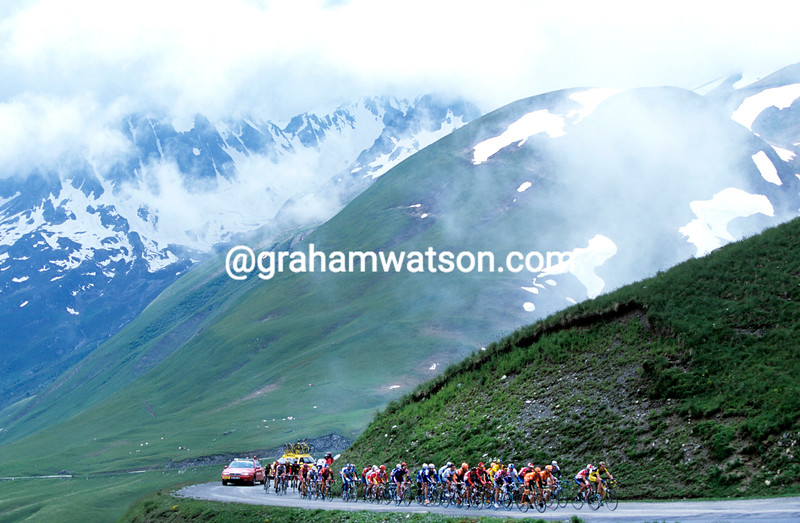 Cyclists climb the Col de la Croix de Fer in the 2001 Dauphine-Libere