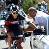 David Tanner is treated by a race doctor on stage two of the 2015 Tour of Spain