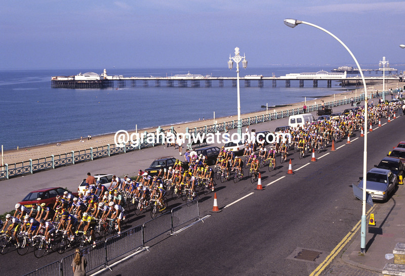 Cyclists pass Brighton Pier in the Wincanton Classic