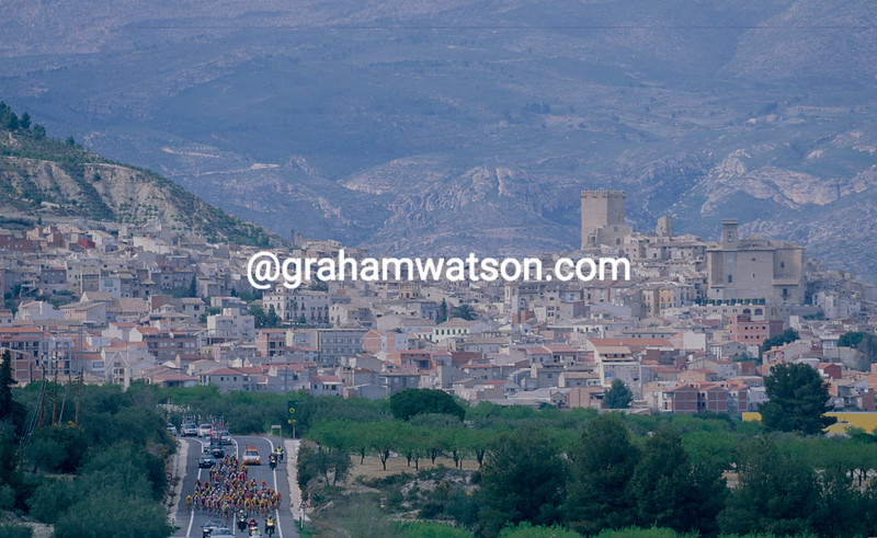 The peloton passes a hilltop village in the 2000 Tour of Murcia