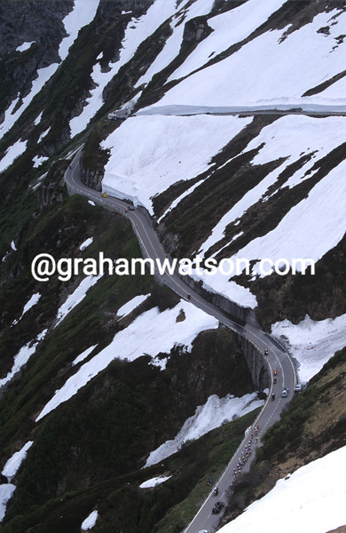 Cyclists climb the Furka Pass in the Tour of Switzerland