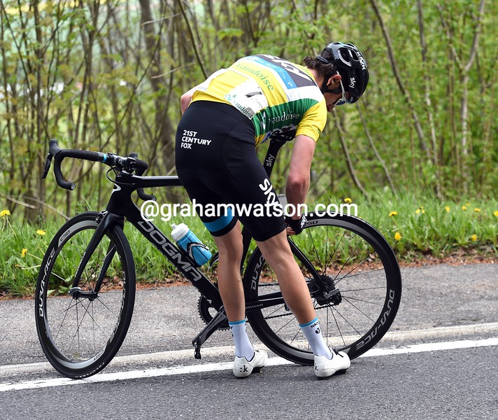 Geraint Thomas makes a wheel-change on stage two of the 2015 Tour de Romandie
