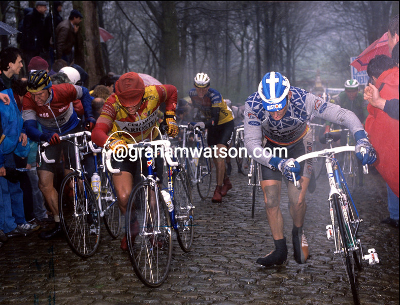 Cyclists walk the Kemmelberg in Ghent-Wevelgem
