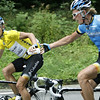 LINUS GERDEMANN GETS A BOTTLE FROM MARCUS BURGHARDT IN THE 2008 TOUR OF GERMANY