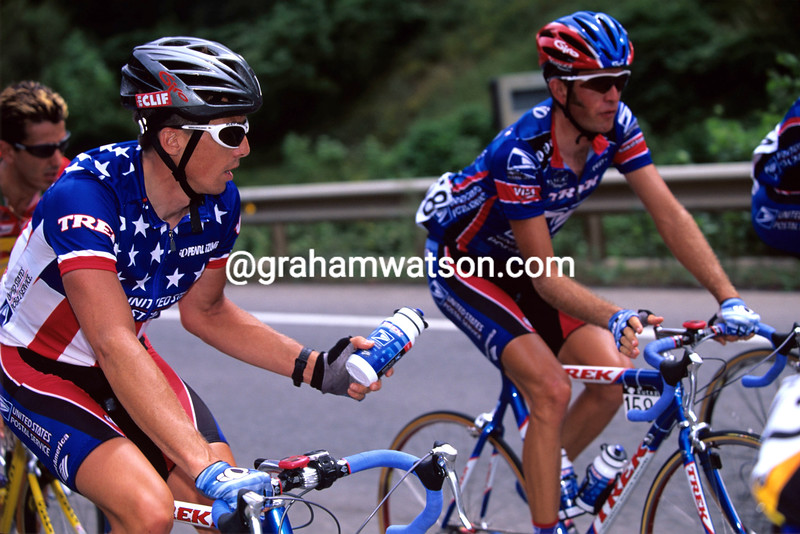 Marty Jemison hands a water bottle to Jonathan Vaughters in the 1998 Tour de France