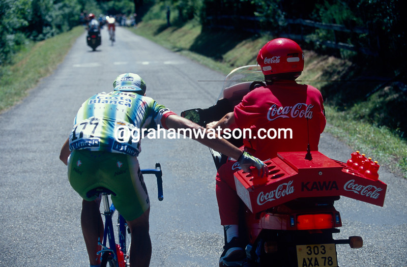 A cyclist grabs water bottles on a stage in the 1996 Tour de France
