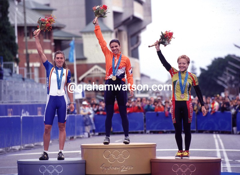 Leontien Van Moorsel celebrates winning the 2000 Olympic Games road race with Hanka Kupfernagel and Diane Ziliute