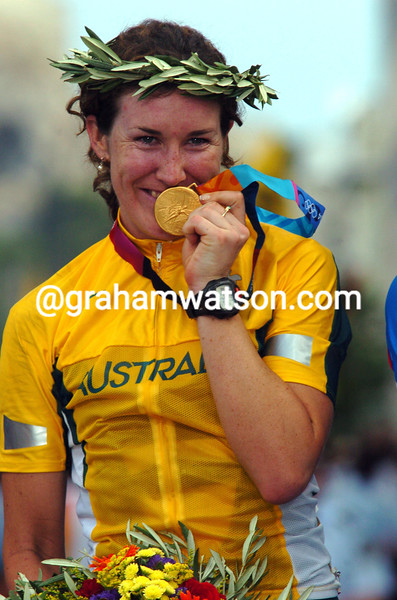 Sara Carrigan celebrates winning her Gold medal in the road race