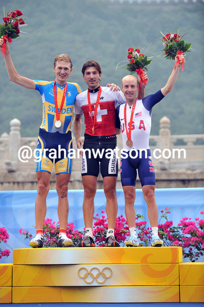 THE MENS TIME TRIAL PODIUM AT THE 2008 OLYMPIC GAMES SHOWS FABIAN CANCELLARA WITH GUSTAV LARSSON AND LEVI LEIPHEIMER