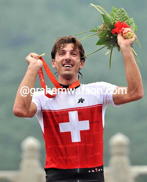 FABIAN CANCELLARA CELEBRATES HIS GOLD MEDAL AT THE 2008 OLYMPIC GAMES TIME TRIAL
