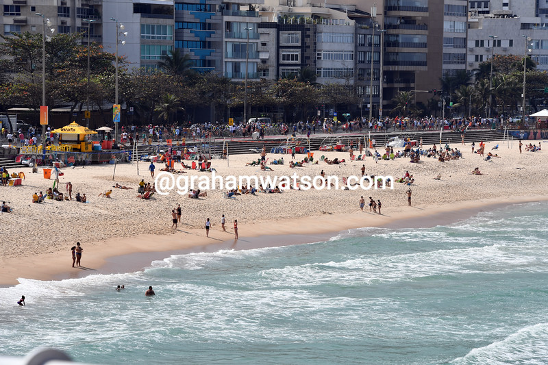 The womens peloton speeds past Copacabana Beach on its way down the coast to the hills