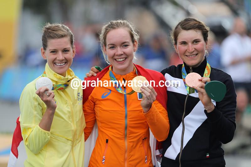 Anna Van der Breggen celebrates her victory with Emma Johansson and Elisa Longo-Borghini