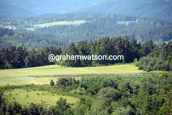 The peloton is strung out across the high plains of the Auvergne, but already four minutes down...