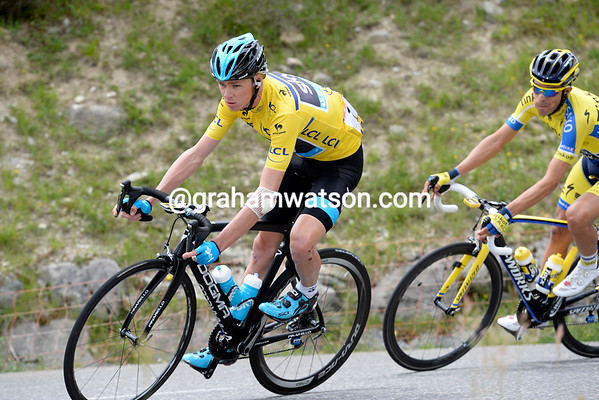 A tired-looking Chris Froome descends the Col with Alberto Contador watching and waiting...