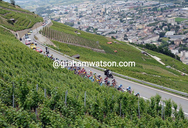 The small peloton climbs between the wines of the Col de la Forclaz - about six minutes down on the escape...