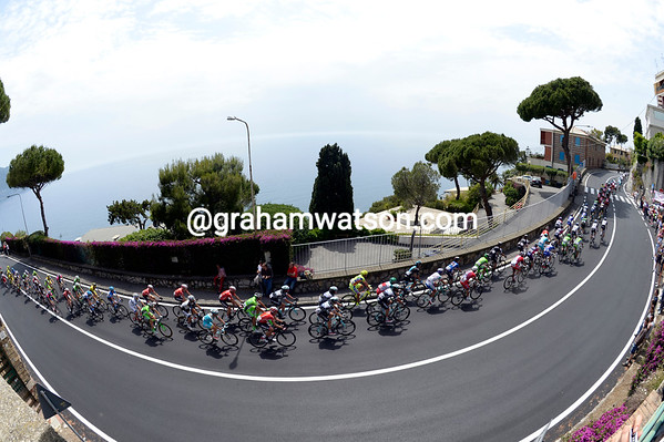 The strung-out peloton is four minutes down as it passes near Rapallo on the Cinq Terre coastline...