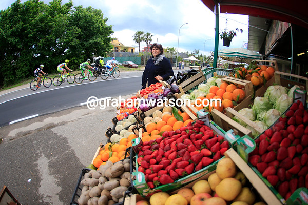 A fruit seller watches the escape as it builds a 14-minute lead...