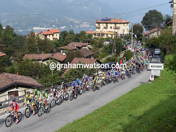 The peloton climbs the Madonna del Ghisallo as the sun starts to burn off the morning mist...