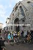 Kwiatkowski leads the peloton as it pedals past Como's giant Basilica...