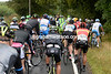The narrow lanes are making things tricky for such a big peloton...